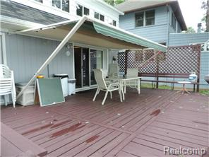 Deck with retractable awning