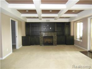 Amazing lower level family/rec room with custom built-ins & fire