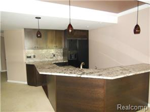 Wet bar/kitchenette in the lower level boasts granite counters.