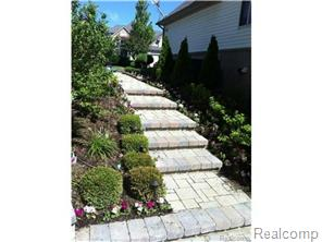 Brick paver stairway from the front to rear yard