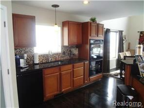 A true cook's kitchen features high-end appliances & 2 sinks.