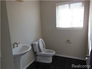First floor powder room w/ pedestal sink