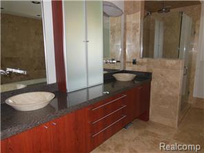 Gorgeous master bath with granite, natural stone & custom cabine