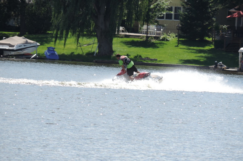 Jet skiing on an all sports lake in Oakland County